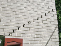 stair-step-foundation-wall-cracks-thm