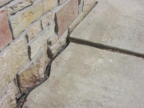 sunken-concrete-sidewalk